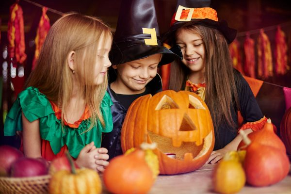 group-of-children-carving-pumpkins